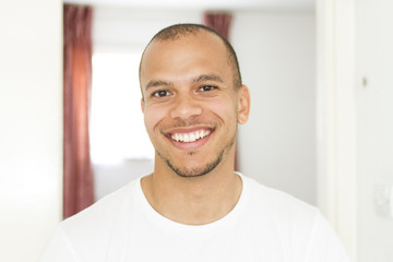 Attractive young man smiling to camera