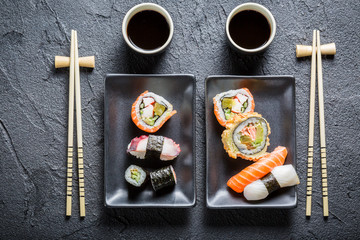 Sushi served with soya sauce for two people