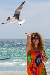woman feeding seagulls