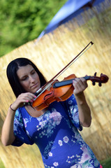 Young Woman Playing Violin Solo