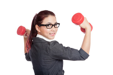 Asian business woman hold dumbbells turn back and smile