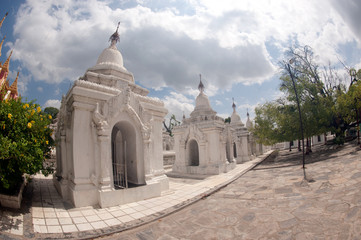 Row of white pagodas in Kuthodaw temple, Myanmar.