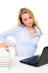 blonde woman with back pain in front of the pc