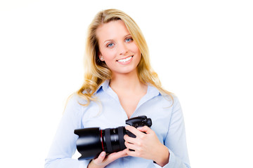young woman holding a digital camera