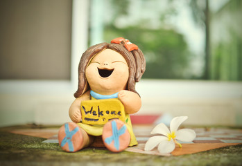 welcome sign stone doll on the table, vintage style