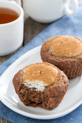 chocolate cakes with cheese filling and cup of tea