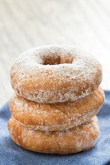 donuts with powdered sugar, close-up