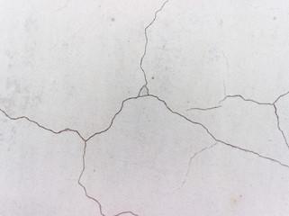 Сrack on a gray wall