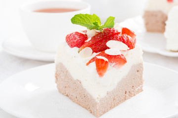 piece of cake with whipped cream and strawberries