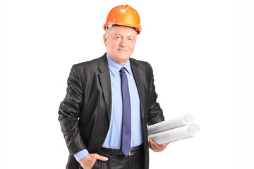 Mature engineer holding construction plans