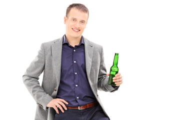 Young male holding a beer
