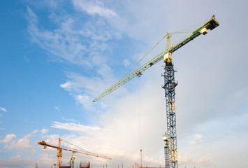 construction cranes on blue sky