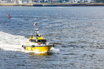 Yellow Pilot Boat Crossing Bay