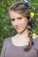 Young girl with beautiful hairstyle, outdoor portrait