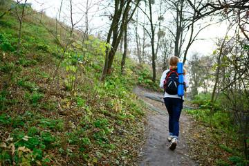Woman hiker walking the mountain trail in weekend