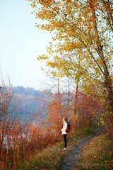Woman hiker on the path in woods