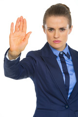 Serious business woman showing stop gesture