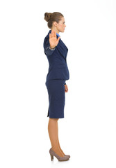 Full length portrait of business woman showing stop gesture