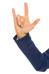 Closeup on business woman showing i love you gesture