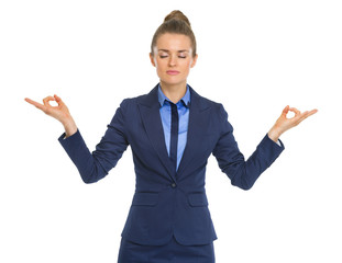Portrait of calm business woman meditating