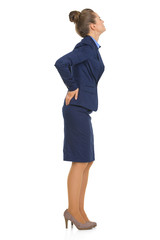 Full length portrait of business woman with back pain