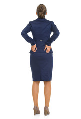 Full length portrait of business woman with back pain. rear view