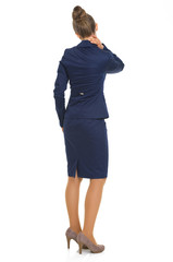 Full length portrait of business woman with neck pain. rear view