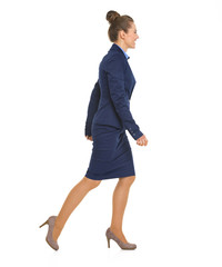Full length portrait of business woman going sideways