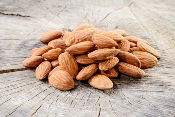 Almond. Nuts on wooden background