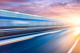 Fototapety Car driving on freeway at sunset, motion blur