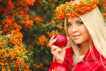 Girl in Orange wreath with Red Apple in hand