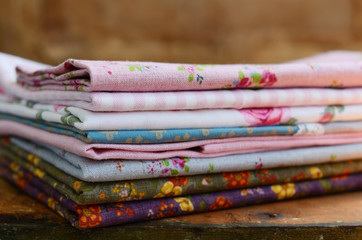 Stack of floral pattern textile in shabby style