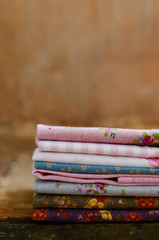 Pile of floral pattern textile in shabby style