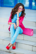 Girl sitting on stairs in colorful clothes