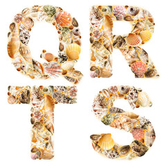 Letter Q R T S made of seashells and sand