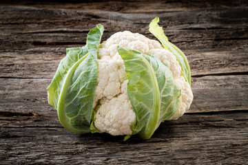 Fresh organic cauliflower on wooden background