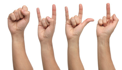 Four differents hand signs isolated on white