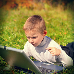 Kid with Laptop outdoor