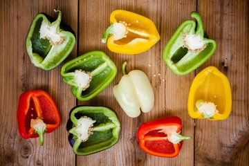 halves of red, green, black, white and yellow bell peppers