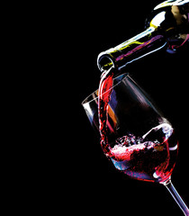 Wine. Red wine pouring into a wine glass