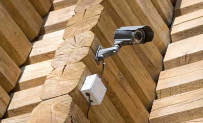 CCTV security camera on a wooden wall
