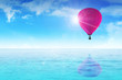 An air balloon floating on blue water