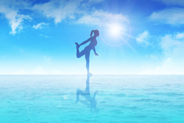 Silhouette illustration of a woman meditating on water