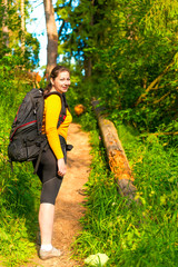 woman with a backpack on a footpath in the forest