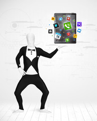 man in full body suit holdig tablet pc