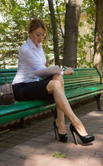 Young business woman reading the document