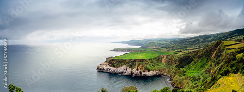 Leinwanddruck Bild Azores Islands coastline in dramatic sky