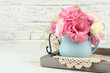 Bouquet of eustoma flowers in vase on wooden background