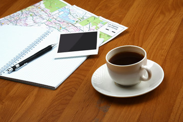 Photo and cup of coffee, paper