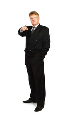 Closeup of a businessman pointing at you , isolated on white